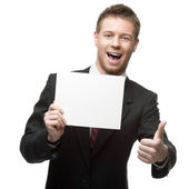 Cheerful businessman holding sign — Stock Photo
