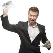 Young successful screaming businessman holding money — Stock Photo