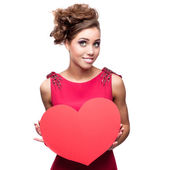 Young cheerful woman holding red paper heart — Stock Photo
