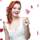 Happy red woman holding lollipop — Stock Photo