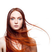 Beautiful red haired with windy hair  — Stock Photo