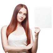 Red girl holding sign — Stock Photo