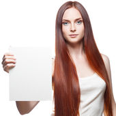 Attractive red girl holding sign — Stock Photo