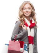 Young smiling woman holding shopping bags — Stock Photo