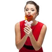 Caucasian woman in red dress holding lollipop — Foto de Stock