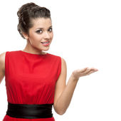 Brunette woman showing empty space — Stock Photo