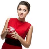 Caucasian woman in red dress holding gift — Foto de Stock