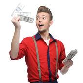 Cheerful retro man holding money — Stock Photo