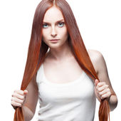 Attractive red girl holding her hair — Stock Photo