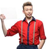 Cheerful retro man holding sign — Stock Photo