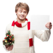 Young smiling man holding sign — Stock Photo