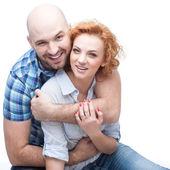 Cheerful hugging couple — Stock Photo