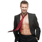 Sexy smiling businessman in red tie — Stock Photo