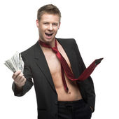 Sexy winking businessman in red tie holding money — Stock Photo