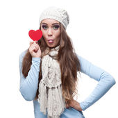 Young cheerful casual woman holding red heart — Stock Photo