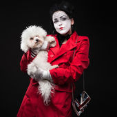 Woman mime with puppy — Stock Photo