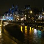 Hotel de Ville and bridge D'Arcole across Seine river at night, Paris, France — Stock Photo #13746720