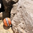 Ball near the ocean rocks — Stock Photo