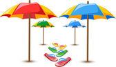 Beach umbrellas and flip flops — Stock Vector