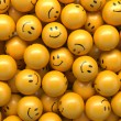 Yellow balls with funny smiley faces — Stock Photo