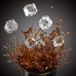 Splashing drink, glass, falling ice cubes — Stock Photo #27618805