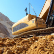 Excavator in the stone mine — Foto Stock