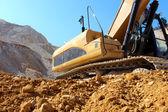 Excavator in the stone mine — Stock Photo