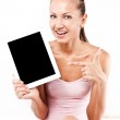 Smiling young beautiful woman with a tablet pc computer at home — Stock Photo