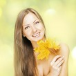 Beautiful smiling woman, holding autumn leaves — Stock Photo