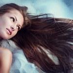 Beautiful young woman with long natural hair — Stock Photo
