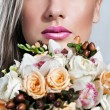 Beautiful female face, young woman, lips, flowers — Stock Photo