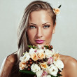 Young beautiful woman with flowers, glamour makeup, perfect clean skin, long hair — Stock Photo