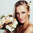Young beautiful woman with flowers, glamour makeup, perfect clean skin, long hair — Stock Photo #13692380