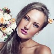 Beautiful woman with flowers, makeup — Stock Photo