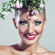 Fashion model, beautiful woman with flowers on her head, glamour makeup — Stock Photo