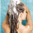 Young attractive woman washing her beautiful long hair — Stock Photo