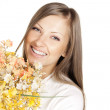Happy young beautiful woman holding flowers — Stock Photo #13693829