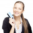 Beautiful young smiling woman holding credit card — Stock Photo