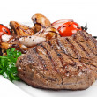 Close-up image of a delicious grilled steak with fresh vegetables — Stock Photo
