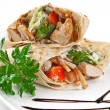 Image of a doner kebab on a white plate - Stock Photo