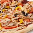 Close-up image of a delicious pizza on a white plate — ストック写真