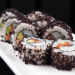 Close-up image of a japanese sushi rolls on a white plate — Stock Photo