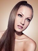 Woman with long straight hair — Stock Photo
