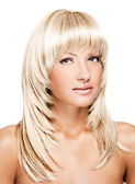 Smiling young beautiful woman with long shiny straight hair in wig — Stock Photo