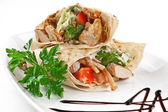 Image of a doner kebab on a white plate — Stock Photo