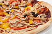 Close-up image of a delicious pizza on a white plate — Stock Photo