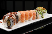 Close-up of a sushi roll, japanese food, mixed set — Stock Photo