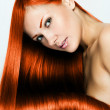 Beautiful young red-headed woman with long shiny hair — Stock Photo #13884913