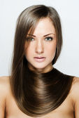 Closeup portrait of a beautiful young woman with long hair — Stock Photo