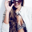 Stock Photo: Beautiful young womin sunglasses posing in studio